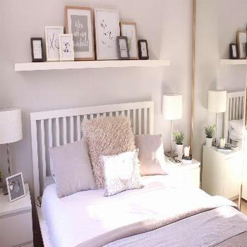 Picture shelf above bed