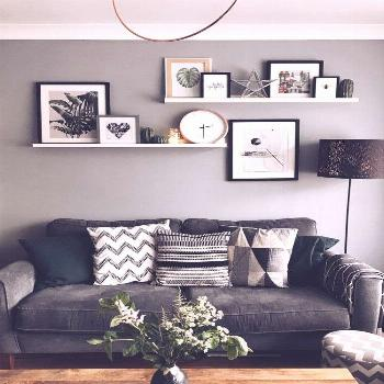 Wall Art is not just pictures and frames. Use pictures ledges to add clocks, fairylights and orname